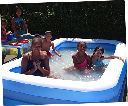 children in a little pool